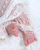 Baby Feet and Lace. Baby feet with white lace cover royalty free stock image