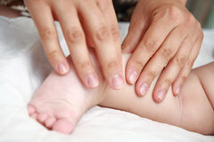 Baby feet massage Stock Image