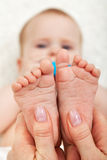 Baby feet massage Royalty Free Stock Image