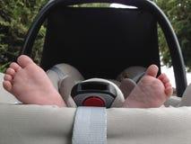 Baby feet at maxi cosi Royalty Free Stock Photo