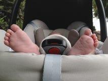 Baby feet at maxi cosi Stock Photo