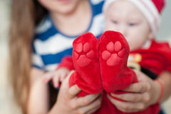 Baby feet in mother hands. Beautiful conceptual image of Maternity Royalty Free Stock Image