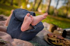 Feet of new born Baby in Hands of parents. Baby feet in mother hands. Mom and her Child. Happy Family concept. Beautiful conceptual image of Maternity royalty free stock photo