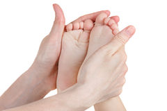 Baby feet in mother's hands isolated on white. Royalty Free Stock Photos