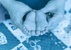 Baby feet on the mothers hand Royalty Free Stock Photos