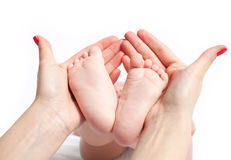 Baby feet in mothers hand Royalty Free Stock Photo
