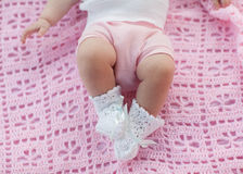 Baby feet in motion. Newborn lying on a pink blanket Royalty Free Stock Photography
