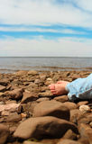 Baby feet outside by water. Adorable baby's feet outside by a large body of water Royalty Free Stock Photo