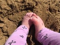 Baby feet on sand stock photos