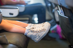 Baby feet on seat in the aircraft Stock Photography