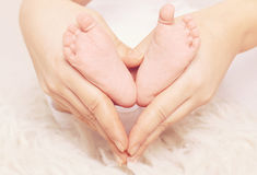 Baby feet in shape heart Royalty Free Stock Photos