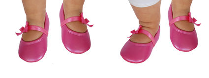 Baby feet/shoes. Isolated baby feet with pink shoes Stock Images