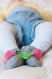 Baby feet with socks and cheerleader Stock Photos