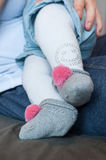 Baby feet with socks and cheerleader Royalty Free Stock Images