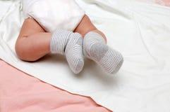 Baby feet in socks Royalty Free Stock Photo