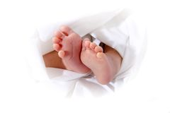 Baby feet in towel. Baby feet in a white  towel Royalty Free Stock Photos