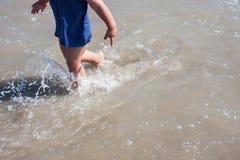Baby feet walking on sand beach Italy. Baby feet walking on sand beach Cesenatico Italy Stock Photography