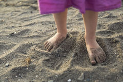 Baby feet walking on sand beach at sunset. A Baby feet walking on sand beach at sunset Stock Images