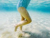 Baby feet walking underwater. Closeup of baby feet walking underwater Stock Images