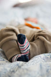 Baby feets in socks Royalty Free Stock Images