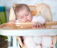 Baby fell asleep after eating Stock Images