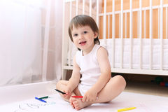 Baby with felt-pens at home Stock Photography