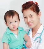 Baby and female doctor Royalty Free Stock Images