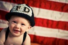 Baby-Feuerwehrmann Stockfotos