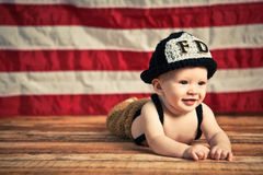 Baby-Feuerwehrmann Stockbild