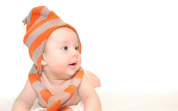 Baby with fez and muffler Stock Photography