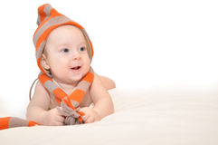 Baby with fez and muffler Stock Photo