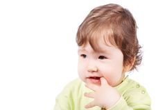 Baby with finger in mouth Royalty Free Stock Photography