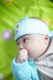 Baby with finger in mouth Royalty Free Stock Photo