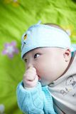 Baby with finger in mouth Royalty Free Stock Photos