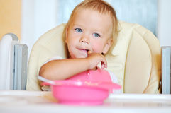Baby with finger in mouth Stock Photography