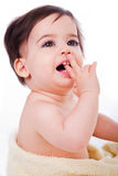 Baby with finger in mouth looking up Stock Image
