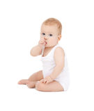 Baby with finger in mouth Stock Photo