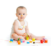 Baby with finger paints Stock Images