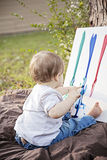 Baby fingerpainting. Baby finger painting on canvas Stock Images