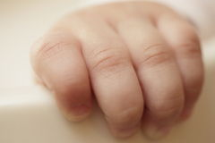 Baby fingers Stock Images