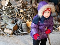 Baby with firewoods. In winter Stock Images