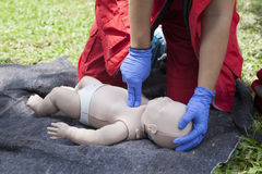 Baby first aid. Baby CPR dummy first aid training. Cardiopulmonary resuscitation - CPR Royalty Free Stock Photo