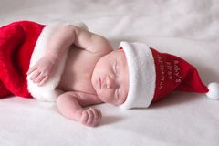 Baby first Christmas. Infant baby celebrating first christmas Stock Photos