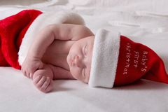 Baby first Christmas. Infant baby celebrating first christmas Royalty Free Stock Images