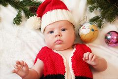 Baby first christmas. Beautiful little baby in Santa hat celebra Royalty Free Stock Images