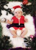 Baby first christmas. Beautiful little baby in Santa hat and jac Royalty Free Stock Image