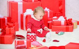 Baby first christmas once in lifetime event. Gifts for child first christmas. Little baby play near pile of wrapped red. Gift boxes. My first christmas. Sharing royalty free stock photo