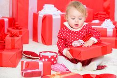 Baby first christmas once in lifetime event. Little baby girl play near pile of gift boxes. Gifts for child first. Christmas. Celebrate first christmas. Sharing royalty free stock image