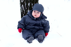 Baby in the first snow Stock Photo
