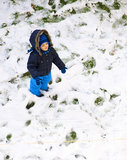 Baby in first snow. A happy baby boy in the first white snow of the winter Royalty Free Stock Photography